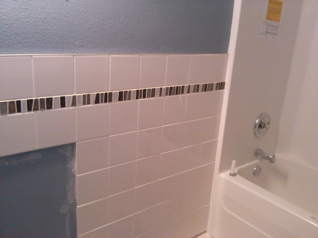 here is a bathroom wall i tiled today